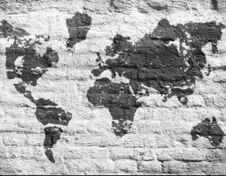 Фотообои Картами мира на фоне кирпичей 22708